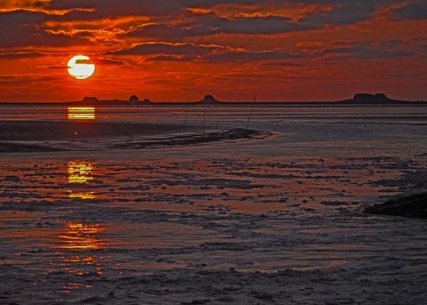 Sonnenuntergang am Holmer Siel